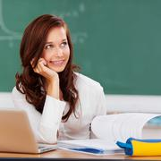 Attractive female student thinking as she studies Stock Photos