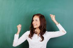 Successful student rejoicing at passing her grades Stock Photos