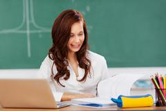 student studying in the classroom - stock photo