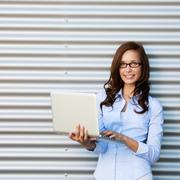 young attractive woman wearing glasses with laptop - stock photo