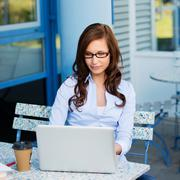 Young attractive woman working outside Stock Photos