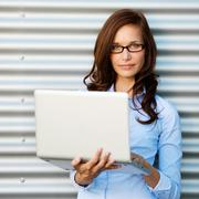 Woman posing while holding the laptop Stock Photos