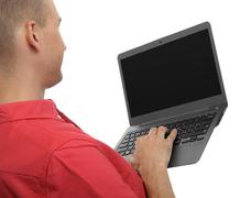 man typing on laptop computer - stock photo