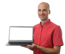 man with a laptop - isolated on a white background - stock photo