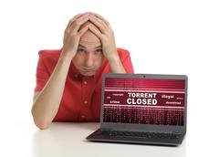Frustrated man with laptop. internet piraty concept Stock Photos