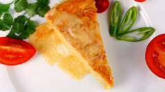 Casserole triangle on white plate Stock Footage