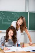 Two schoolgirls work together in a group work Stock Photos