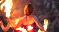 Two sexy women make plastic movements with burning  fire fans HD Footage