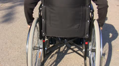 Man in a wheelchair rear view Stock Footage