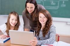 students with laptop - stock photo