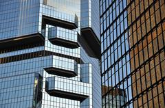 Glass skyscrapers reflecting light, Hong Kong Island - stock photo