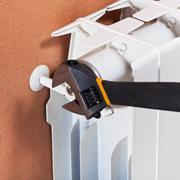 Adjusting heating radiator Stock Photos