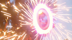 Spinning firework wheel, sparkles all around, fire show performance Stock Footage