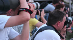 Photographers taking long range photos of event - stock footage