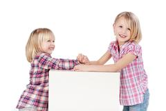 Little girls arm wrestling Stock Photos