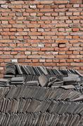 Brick Wall and Chinese Tiles Stock Photos
