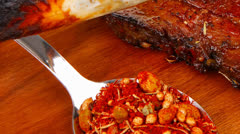 Savory plate on wood : grilled ribs Stock Footage
