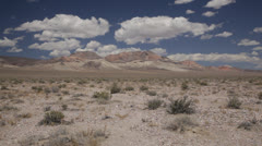 High desert mountain puffy clouds, backgrounds,1021  Stock Footage