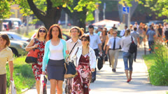 Crowd  people in  summer  morning . Slow motion Stock Footage