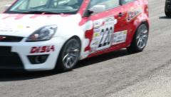 Racing track tarmac cars pass by Stock Footage