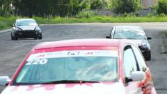 Racing sport cars pass by track tarmac during race laps Stock Footage