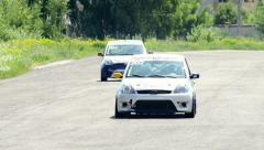 Sport racing cars approach turn roaring motors at day time race - stock footage