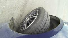 Car wheel rolling on asphalt Stock Footage