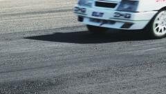 Sport cars pass by track tarmac at racing competition daytime - stock footage