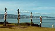 Shaman poles at lake baikal Stock Footage
