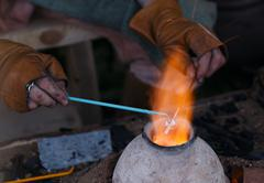 Glass artist in his workshop - stock photo