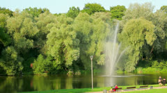 Green trees and lake in park Stock Footage