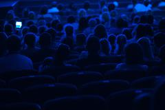 Audience in the cinema. Silhouette. - stock photo
