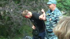 Police arrested a beaten man - stock footage