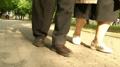 The legs of the two older people Stock Footage
