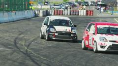 Group of cars taking the turn during racing hot pursuit competition Stock Footage