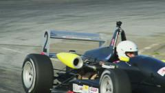F1 Formula1 moments, cars pass by with roaring sound in persuit of leader Stock Footage