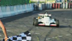 Stock Video Footage of Formula 1 F1 finishing checkered flag for race. Finish symbol, competition.