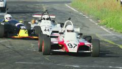 Formula 1 racing cars race begins, all cars start off driving competition - stock footage