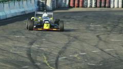 Formula 1 F1 driving cars on track during competition racing at daytime - stock footage