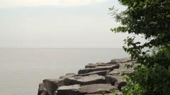 Man walking on large boulders Stock Footage