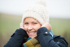 happy young woman wearing knit hat - stock photo