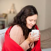 Stock Photo of woman drinking coffee in winter at home