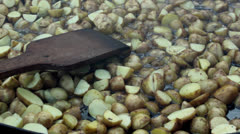 Potatoes roasted in butter,roast potatoes, Stock Footage