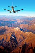 aircraft in mountain landscape - stock photo