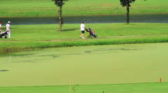 Playing golf Stock Footage