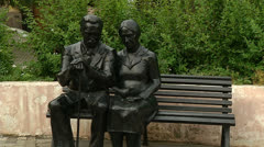 Sculpture of a man and a woman on the bench Stock Footage