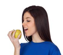 teenager girl with a yellow apple - stock photo