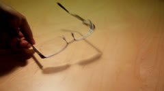 Placing a Pair of Eyeglasses on a Table Stock Footage