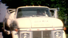 Old film 1960s farming bulk milk big milk truck milkman vintage lifestyle work Stock Footage