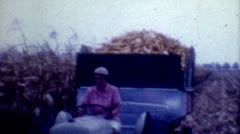 8mm Film 1960s female farming corn working tractor food production vintage old Stock Footage